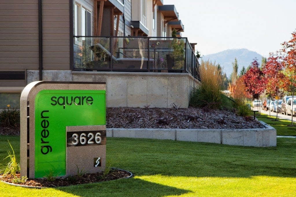 green square sign 3626 besides condo units