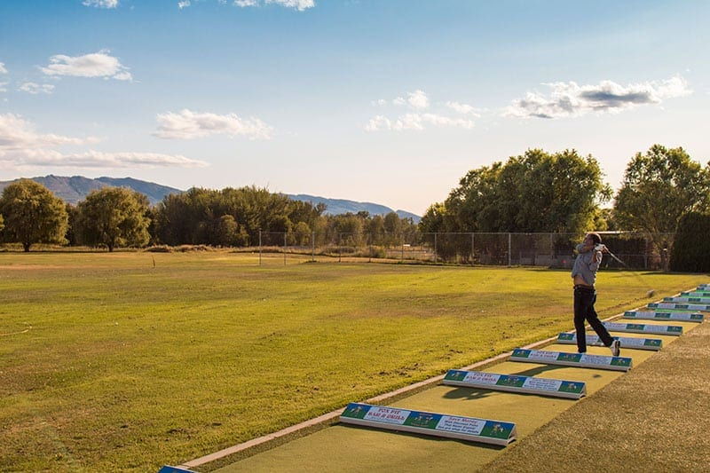 Kelowna mission creek golf course man practicing his drive