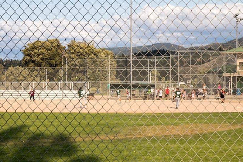 Kelowna Baseball at mission recreational park through a gate