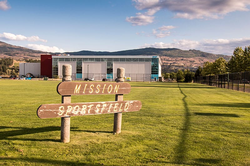 Mission Sports Field sign with grass surrounding it