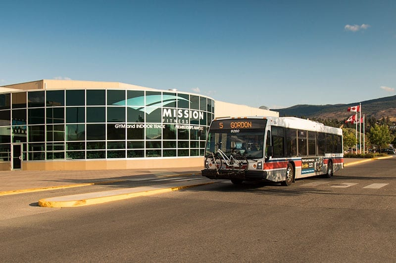 Mission Fitness exterior shot public transit bus parked right in front of the centre