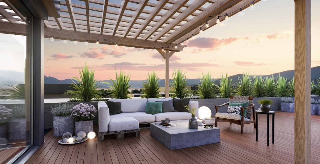 green square sunset exterior patio shot with cushioned and pillowed chairs and a table with multiple houseplants